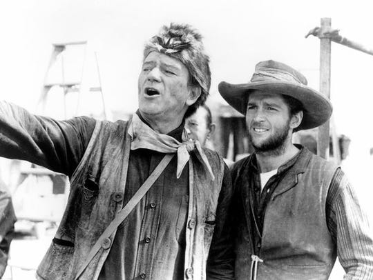 Actor/stuntman Dean Smith, right, with John Wayne on