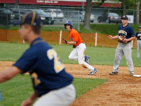 Edison's Kevin Harmer eyes first base from second before