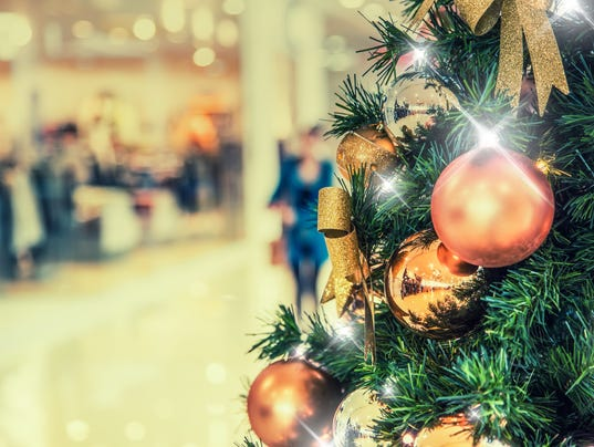 Christmas tree with gold decoration in shopping mall