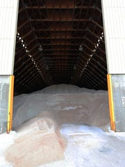 Members of the Piscataway Township Department of Public Works start their snow preparation as they get snow plow trucks, salt spreaders and loaders ready for the Blizzard of 2016 on Friday, Jan. 22, 2016. Here, 3,500 tons of salt waits to be spread onto the roadways of Piscataway.