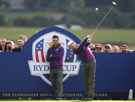 Europe's Rory McIlroy plays off the 14th tee as Martin Kaymer looks on during a practice round ahead of the Ryder Cup golf tournament at Gleneagles, Scotland, Wednesday, Sept. 24, 2014. (AP Photo/Peter Morrison)
