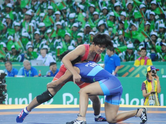 Rckaela Aquino, of Team Guam, in red uniform, battles India's Pooja Dhanda in the bronze medal match Sept. 24 at the 5th Asian Indoor and Martial Arts Games, in Turkmenistan. Dhanda won the bronze.