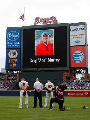The flag was lowered to half-staff and a moment of silence was held Sunday at Turner Field in memory of Greg Murrey.