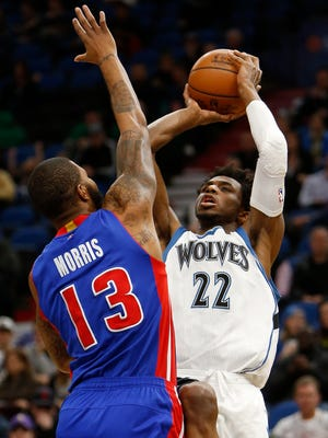 Timberwolves forward Andrew Wiggins (22) shoots against Pistons forward Marcus Morris (13) in the first half Friday in Minneapolis.