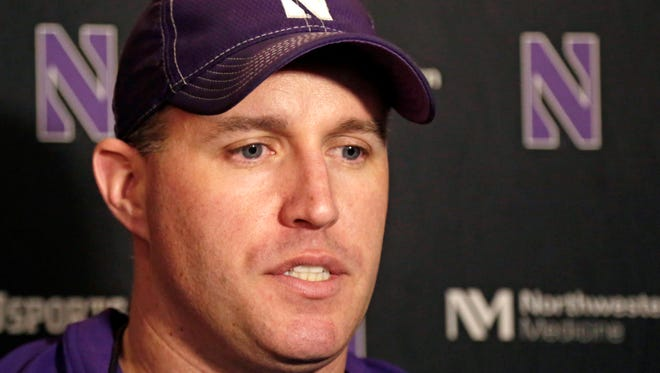 In this April 1, 2014, file photo, Northwestern head football coach Pat Fitzgerald speaks at a news conference.