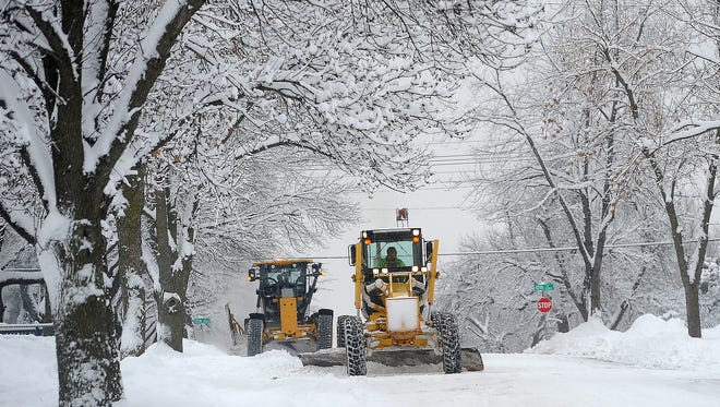 Plows clean up Omaha Ave. after the area received around 9 inches of snow in Sioux Falls, S.D. on Tuesday, Dec. 1, 2015.