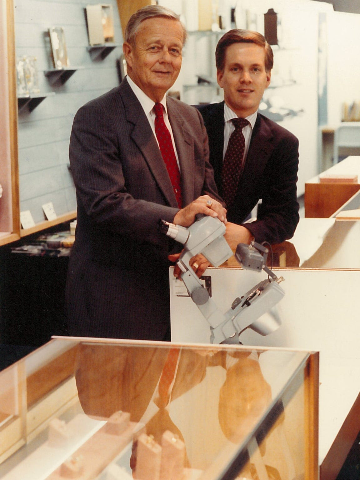 Frank and Don Fite pose at Busch Jewelers in 1990.