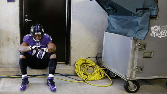 Ray Rice waits for his introduction before a Baltimore Ravens game against the Cincinnati Bengals on Nov. 10. He's suspended now, but can he rehab his image enough to come back?