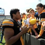 Jay Scheel signs autographs before the Hawkeyes' spring game on April 23.