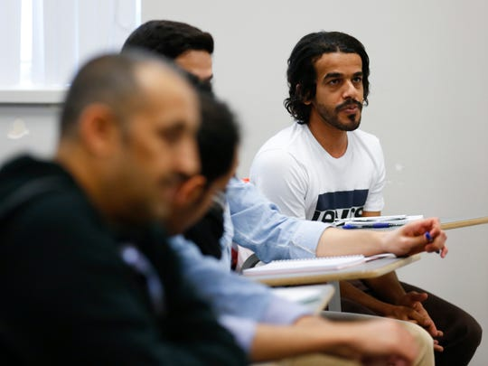 Jameel Alharbi participates in a class discussion during a writing class at the English Language Institute at Missouri State University on Tuesday, Feb. 20, 2018. Twenty-eight English teachers from Saudi Arabia are taking part in a 12-month teacher training program at Missouri State University with the goal of improving the educational system in Saudi Arabia.