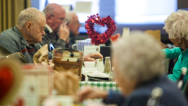 People eat lunch at the Cedar City senior citizen center, Wednesday, Feb. 10, 2016.