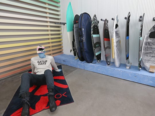 A variety of surf boards at the newly opened Neon Wave