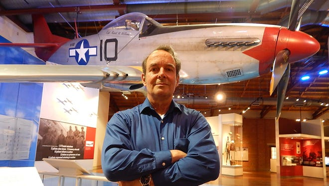 Historian Dan Haulman stands in front of a P-51 Mustang replica at the Tuskegee Airman Museum on May 13, 2014. Of 179 bomber escort missions involving the Tuskegee Airmen, 27 U.S. bombers were lost during seven of those missions, Haulman said.