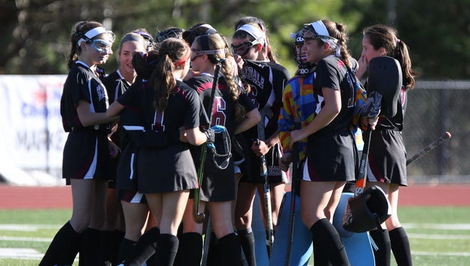 Scarsdale players console each other after the lost to Shenendehowa 1-2 for the NYSPHSAA Class A Championships that was held at Maine-Endwell High School in Endwell, NY.