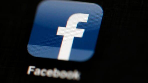 Facebook logo is displayed on an iPad.