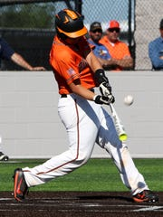 Burkburnett's Wyatt Grant hits a fly-ball against Sweetwater during Game 2 of the Region I-4A bi-district playoff Friday, May 4, 2018, in Iowa Park.