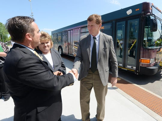 Green Bay Mayor Jim Schmitt, left, Green Bay Metro transit director Patty Kiewiz and Packers President and CEO Mark Murphy chat after announcing the free G-line bus route connecting Lambeau Field with downtown Green Bay.