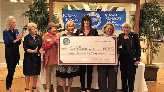 The board of the Treasure Coast Chapter of World Wings International presents a $9,000 check to SafeSpace's Director of Development Tracy Levy. Pictured are, from left, Laila White, Lissie Carino, Pamela Iden, Eva D'Angelico, Tracy Levy, Cathy Liddy and Kathy DeMont.
