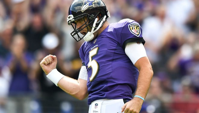 Baltimore Ravens quarterback Joe Flacco (5) reacts to running back Terrance West's touchdown during the first half of an NFL football game against the Cleveland Browns in Baltimore, Sunday, Sept. 17, 2017.