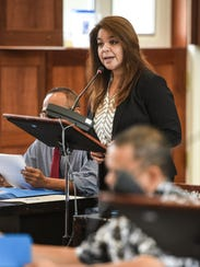 Sen. Louise Muña talks about a bill that would require insurance companies to provide coverage for the costs of prostate and cervical cancer screening tests during session at the Guam Congress Building in Hagåtña on Monday, April 24, 2017.