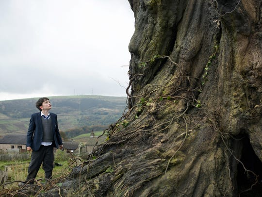 Conor (Lewis MacDougall) finds that an old tree next