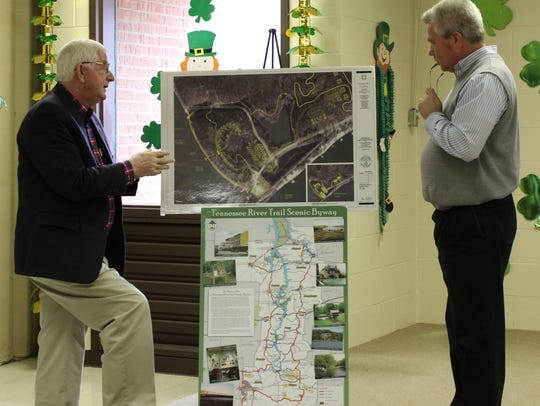 Houston County Mayor George Clark, left, explains the