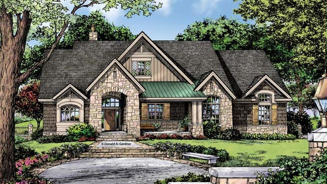 A dramatic stone arch frames the entryway beautifully.