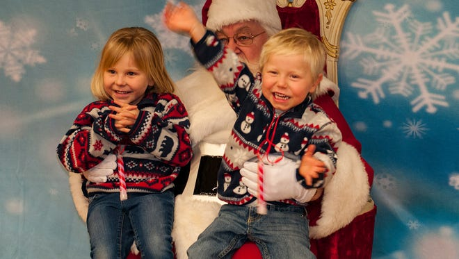 Owen and sister Lillyah are all smiles while visiting with Santa.