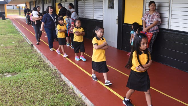Kindergarten teacher Pearl Hamada walks with some of her student to their classroom at Chief Brodie Memorial Elementary School in this 2017 file photo.