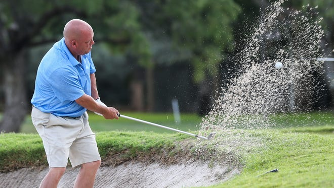 Clint Adams hits the ball out of the bunker in hole one during the Men's Partnership Thursday, July 13, 2017, at Bentwood County Club.