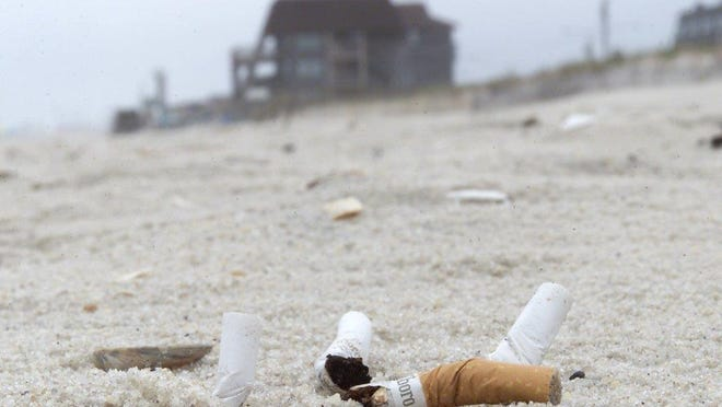 A New Jersey bill that bans smoking on beaches and parks doesn't specify who is responsible for enforcing the measure.