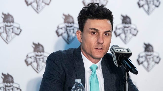 New York Liberty's general manager Jonathan Kolb speaks to reporters during a news conference at Barclays Center in New York. Kolb knew that he and first-year coach Walt Hopkins would have to make some tough decisions on the team's roster this year. He just didn't think they'd have to do it so quickly and without seeing players compete on the court in training camp. The WNBA and the players' union decided that teams would have to get their rosters under the salary cap by Tuesday, May 26, so that the players could start getting paid on June 1.