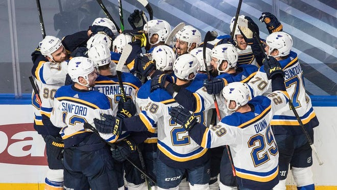 St. Louis Blues celebrate a goal during against the Vancouver Canucks during overtime in Game 3 of an NHL hockey first-round playoff series, Sunday, Aug. 16, 2020, in Edmonton, Alberta.