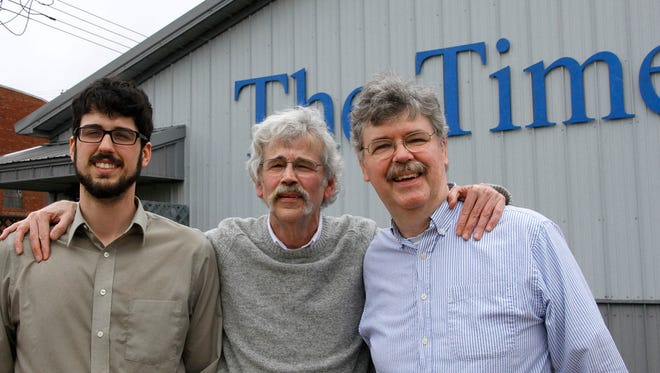 From left: Tom, Art and John Cullen stand outside of The Storm Lake Times office in Storm Lake. Art Cullen won a Pulitzer Prize for Editorial Writing on Monday, April 10, 2017.