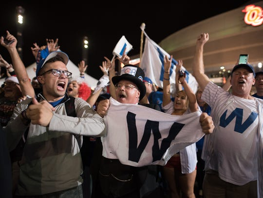 Cubs fans celebrate after the Chicago Cubs defeat the