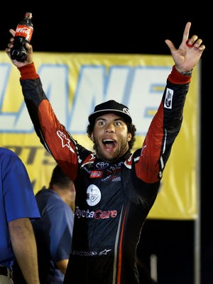 Darrell Wallace Jr. celebrates after winning the NASCAR Truck Series auto race at Gateway Motorsports Park.