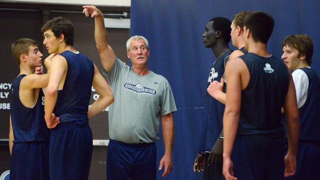Dakota Schoolers 17 coach Kent Mueller talks with his players during practice June 21 at the Sanford Pentagon.
