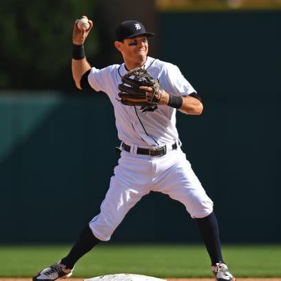 Tigers second baseman Ian Kinsler completes a double