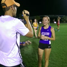 Fletcher's Kayley Delay is interviewed after the girls elite race which she won with a time of 18:35.