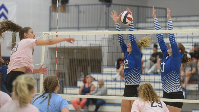 Volleyball will be played through District 10 on Tuesday. In this Aug. 31, 2019 file photo, Corry's Rachel Brady, left, tries to hit past Fort LeBoeuf's  Anna Bayer (12) and Audrey Freidman (10) in the semifinal game of the Fort LeBoeuf's girls volleyball tournament  at Fort LeBoeuf High School.