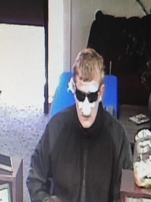 Douglas County Sheriff's Office released a security photo of a man with a bandaged face and sunglasses, who reportedly robbed a U.S. Bank Wednesday in Minden.