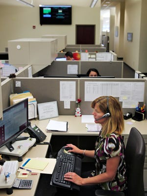 Alesha Donnelly, a team leader for the participant services call center at Benefit Resource Inc. in Henrietta, takes a call from a customer.  Donnelly is from Gananda.