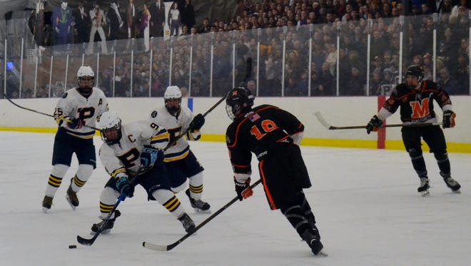 Pelham captain Ben Hurd takes a shot in front of a sold-out crowd Monday at the Ice Hutch. The Pelicans beat Mamaroneck 4-2 in a matchup of the states' two No. 1 teams.