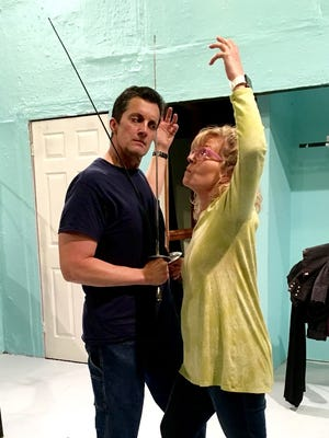 "David Cerreta and Delight Clements rehearse for ""Moon Over Buffalo,"" a comedy about a troupe of actors whose personal lives get in the way of an important performance. The play opens March 24 at Backdoor Theatre."