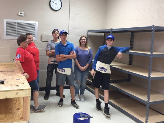 Lowe's employees recently helped set up shelving units