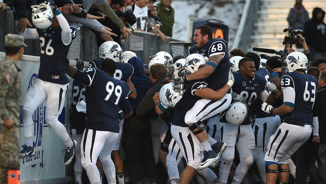 Nevada players and fans celebrate an overtime win at Mackay Stadium in 2015.