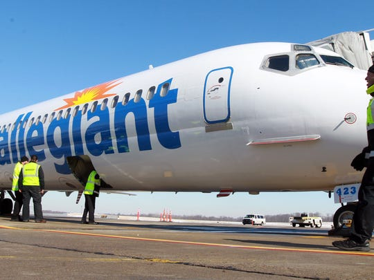 Ground crew members prepare the first Allegiant Air departure from Cincinnati/Northern Kentucky International Airport on February 12.