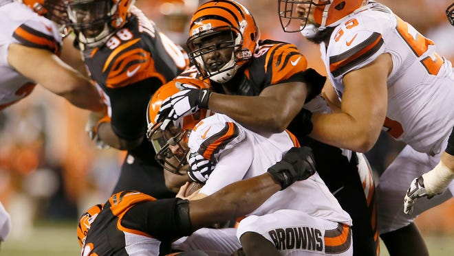 Bengals defensive linemen Geno Atkins (97) and Carlos Dunlap (96) sack Browns quarterback Johnny Manziel during the Bengals' 31-10 win on Nov. 5.
