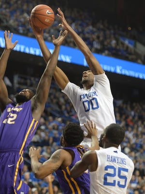 UK's Marcus Lee grabs a rebound during the University of Kentucky basketball game against Albany at Rupp Arena in Lexington, Ky., on Friday, November 13, 2015. Photo by Mike Weaver