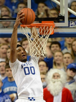 UK's Marcus Lee dunks during the University of Kentucky mens basketball game against University of Louisville at Rupp Arena in Lexington, Ky., on Saturday, December 26, 2015. Photo by Mike Weaver